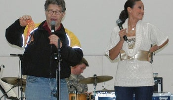 In this image provided by the U..S,. Army, then-comedian Al Franken and sports commentator Leeann Tweeden perform a comic skit at Forward Operating Base Marez in Mosul, Iraq, on Dec. 16, 2006
