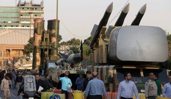 FILE PHOTO- A Russian-made S-300 air defense system, left, is on display in Tehran, Iran, Sunday, Sept. 24, 2017.