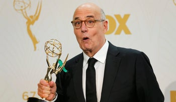 """Actor Jeffrey Tambor poses backstage with his award for Outstanding Lead Actor In A Comedy Series for Amazon Studios' """"Transparent"""" at the 67th Primetime Emmy Awards, September 20, 2015."""