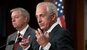 "File photo: Senate Foreign Relations Committee Chairman Sen. Bob Corker, joined at left by Sen. Lindsey Graham speaks with reporters after his panel approved the ""Taylor Force Act"" in Washington on August 3, 2017."