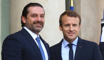 File photo: France's President Emmanuel Macron, right, welcomes Lebanon Prime Minister Saad Hariri, prior to a meeting, at the Elysee Palace, Paris Friday, Sept. 1, 2017.