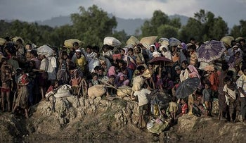 File photo: Rohingya refugees wait after crossing the Naf river from Myanmar into Bangladesh in Whaikhyang on October 9, 2017.
