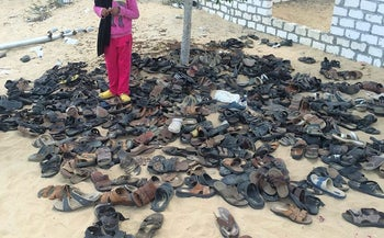 Discarded shoes of victims remain outside Al-Rawda Mosque in Bir al-Abd northern Sinai, Egypt. a day after attackers killed hundreds of worshippers, on Saturday, Nov. 25, 2017