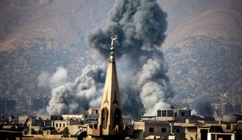 Smoke rising following a reported air strike on the rebel-held besieged town of Arbin, in the Eastern Ghouta region on the outskirts of Damascus on November 23, 2017