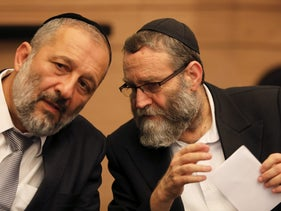 Israel's Interior Minister Arye Dery speaks to Moshe Gafni during a meeting at the Knesset in Jerusalem September 13, 2017.