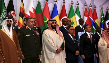 Saudi Crown Prince Mohammed bin Salman (C) poses for a photograph with chiefs of staff of a Saudi-led Islamic military counter terrorism coalition during their meeting in Riyadh November 26, 2017
