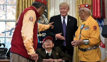 U.S. President Donald Trump greets Navajo veterans in the Oval Office of the White House during an event honoring Native American code talkers, November 27, 2017.