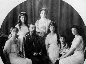 Russia's last Czar Nicholas II, seated second from left, Czarina Alexandra, center rear, and their family in an undated photo.