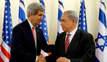 U.S. Secretary of State John Kerry shakes hands with Israeli Prime Minister Benjamin Netanyahu (R) during a news conference following a meeting at Netanyahu's office in Jerusalem December 5, 2013.