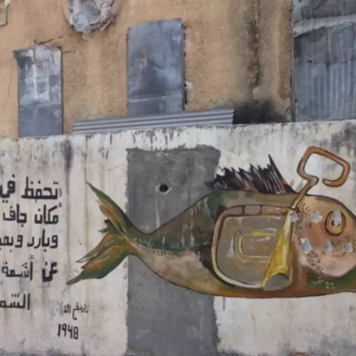 Alaa Albaba's graffiti, in Ajami, Jaffa: 'Keep in a cold and dry place'