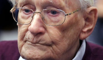 SS sergeant Oskar Groening listens to the verdict of his trial at a court in Lueneburg, northern Germany on July 15, 2015