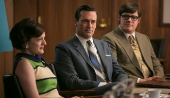 In this image released by AMC, Elisabeth Moss, from left, Jon Hamm and Rich Sommer appear in a scene from 'Mad Men.'