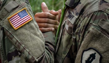 FILE PHOTO: Soldiers assigned to the 1st Mission Support Command, U.S. Army Reserve, shake hands in Puerto Rico, on Saturday, Oct. 7, 2017