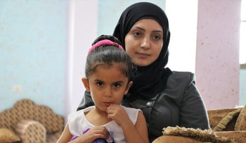 Aisha Hassouna and her daughter Lara, whose 4-year-old twin sister Yara died in July, in the Gaza Strip.
