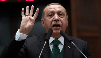 File photo: Turkish President Tayyip Erdogan addresses members of parliament from his ruling AK Party (AKP) during a meeting at the Parliament in Ankara, Turkey, November 7, 2017.
