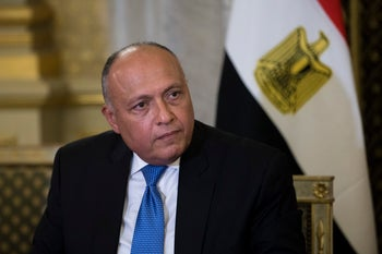 Egyptian Foreign Minister Sameh Shukri looks at his French counterpart Jean-Yves Le Drian in Paris, Tuesday Oct. 24, 2017. Egyptian President Abdel-Fattah el-Sissi met with French President Emmanuel Macron on as part of a three-day visit to France focusing on economic cooperation and the fight against extremism. (AP Photo/Kamil Zihnioglu, Pool)