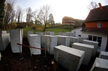 The pared-down version of Berlin's Holocaust memorial built by German political art activists next to the home of Bjoern Hoecke, a senior AfD member who has criticized the Belin memorial. Bornhagen, Germany, November 22, 2017