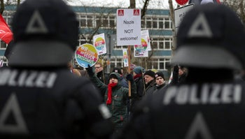Police officers observe a protest rally against a party convention of the Alternative for Germany, AfD, party in Hanover, Germany. Dec. 2, 2017