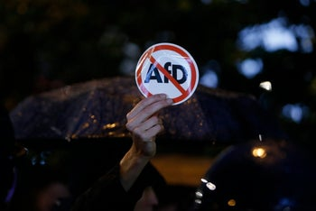 Police block demonstrators protesting against the far-right AfD party after parliamentary election polling stations closed. Berlin, Germany, Sept. 24, 2017,
