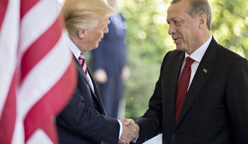 """U.S. President Donald Trump, left, shakes hands with Recep Tayyip Erdogan, Turkey's president, at the West Wing of the White House in Washington, D.C., U.S., on Tuesday, May 16, 2017. Erdogan said he's looking forward to a """"decisive meeting"""" with his U.S. counterpartTrump, whose decision to arm Kurdish groups against Islamic State in Syria has stoked tensions between the two NATO members. Photographer: Andrew Harrer/Bloomberg"""