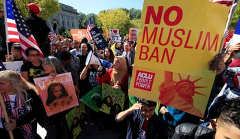 FILE PHOTO: Protesters against President Trump's travel ban gather at a rally in Washington on Oct. 18, 2017