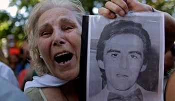 FILE PHOTO: Pepa Pussek holds a picture of her son Juan Carlos Galvan, one of the victims of Argentina's 'dirty war,' in Cordoba, Argentina, Wednesday Dec. 22, 2010.