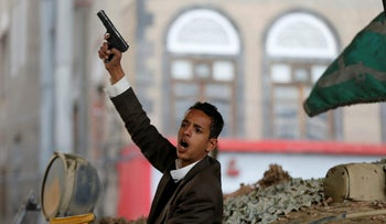 A Houthi militant reacts as he sits on a tank after the death of Yemen's former president Ali Abdullah Saleh in Sanaa, Yemen December 4, 2017. REUTERS/Khaled Abdullah     TPX IMAGES OF THE DAY