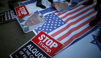 Palestinian protesters prepare to burn posters depicting U.S. President Donald Trump and Israeli PM Benjamin Netanyahu during a protest against Trump's decision to recognize Jerusalem as the capital of Israel. Gaza City, December 7, 2017