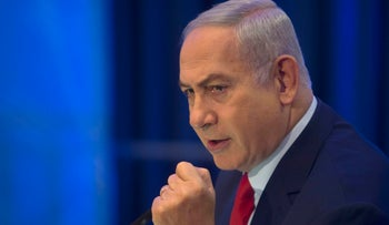 Prime Minister Benjamin Netanyahu gestures as he speaks during a conference at the Foreign Ministry in Jerusalem, Thursday, December 7, 2017.
