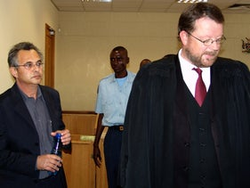 "FILE PHOTO: Former COMVERSE CEO Jacob ""Kobi"" Alexander (L) and his advocate Rudi Cohrssen (R)  leave the court in Windhoek, in this picture taken October 3, 2006."