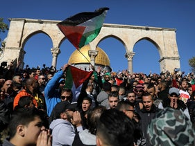 Worshippers waving Palestinian flags after Friday prayers on the Al-Aqsa compound in Jerusalem's Old City, December 8, 2017.