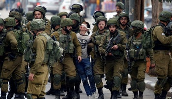 Israeli forces detain Palestinian Fevzi El-Junidi, 14-year-old, following clashes after protests against a decision recognize Jerusalem as the capital of Israel, in Hebron, 07 December 2017.