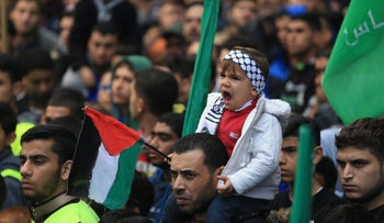 A toddler yawns as Palestinians take part in a Hamas rally in the Gaza Strip's Jabalia refugee camp on December 8, 2017