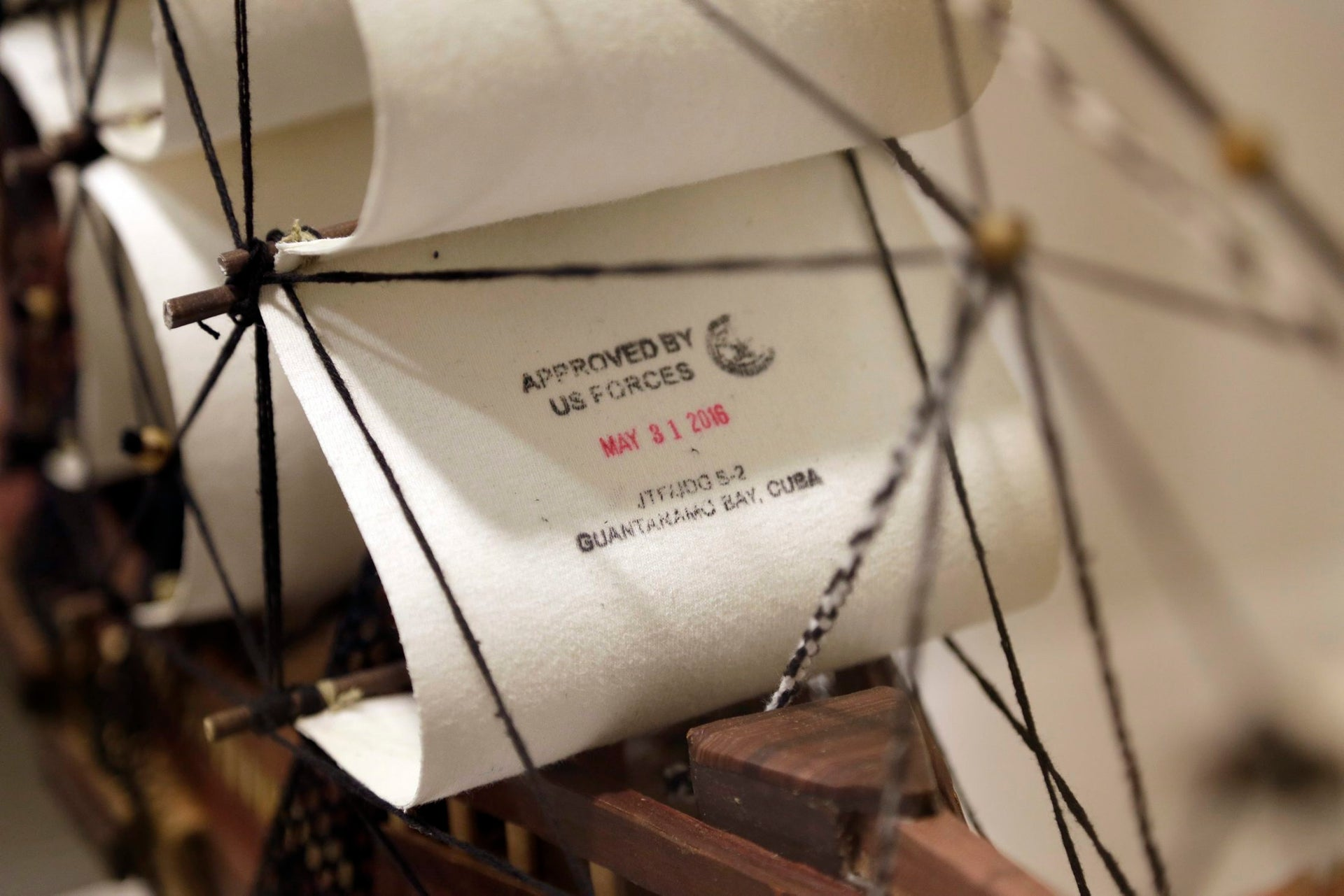 "A sculpture of ship is stamped ""Approved by US Forces"" at an exhibition at the John Jay College of Criminal Justice of an artwork by Guantanamo detainees, November 27, 2017."