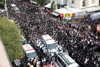 People attend the funeral of top spiritual authority for ultra-Orthodox Jews in Israel and around the world, Rabbi Aaron Yehuda Leib Shteinman, in the central Israeli city of Bnei Brak on December 12, 2017.