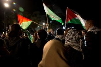 Israeli Arabs in protest outside the U.S. embassy over Trump's Jerusalem move on Tuesday, December 12, 2017.