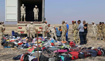 Russian emergency services personnel and Egyptian servicemen working at the crash site of a A321 Russian airliner in Wadi al-Zolomat, a mountainous area of Egypt's Sinai Peninsula, November 2, 2015.
