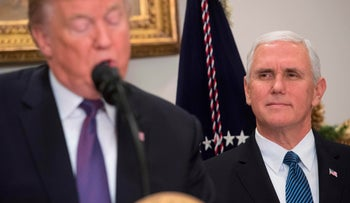 U.S. President Donald Trump speaks alongside Vice President Mike Pence during an event at the White House. December 7, 2017.