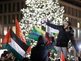 Protesters demonstrate outside the U.S. embassy in Berlin, Germany December 8, 2017