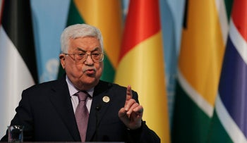 Palestinian President Mahmoud Abbas gestures as he talks during the closing news conference following the Organisation of Islamic Cooperation's Extraordinary Summit in Istanbul, Wednesday, Dec. 13, 2017