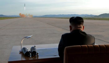 North Korean leader Kim Jong Un watches the launch of a Hwasong-12 missile in this undated photo released by North Korea's Korean Central News Agency, September 16, 2017.