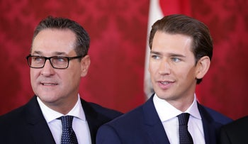 Austrian Vice Chancellor Heinz-Christian Strache (L) and Chancellor Sebastian Kurz attend the inauguration of the new government in Vienna, December 18, 2017.