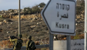 Israeli soldiers outside the village of Qusra