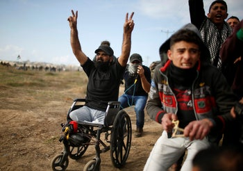 Wheelchair-bound Palestinian demonstrator Ibraheem Abu Thuraya, who according to medics was killed later on Friday during clashes with Israeli troops, gestures during a protest against U.S. President Donald Trump's decision to recognize Jerusalem as the capital of Israel, near the border with Israel in the east of Gaza City December 15, 2017.    TPX IMAGES OF THE DAY