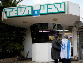 Workers of Teva Pharmaceutical Industries stand at the entrance to their facility in Ashdod, Israel December 17, 2017.