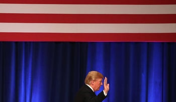 U.S. President Donald Trump walks off the stage after delivering a speech at the Ronald Reagan Building December 18, 2017 in Washington, DC.
