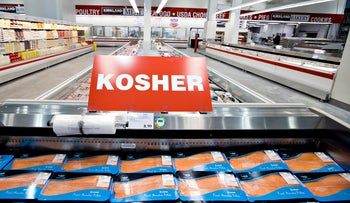 Packets of fish stacked in the kosher aisle in a New York Cotsco. The new Flemish ban on ritual slaughter without stunning will essentially render strict Jewish and Muslim ritual killing impossible.