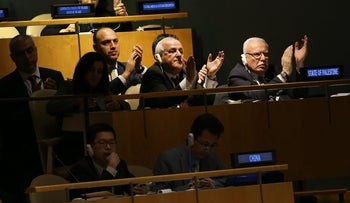 Members of the Palestinian delegation leave the General Assembly hall after a vote in which the United States declaration of Jerusalem as Israel's capital was declared 'null and void' on December 21, 2017
