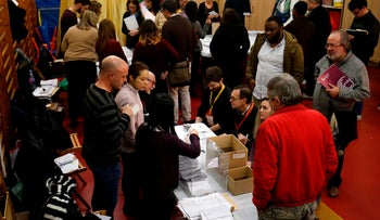 Polling supervisors recount ballots at the Catalan regional elections in Barcelona on December 21, 2017