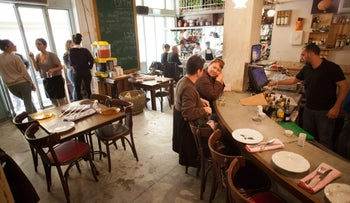"The Mahneyuda restaurant in Jerusalem. ""Organized chaos"" is chef Assaf Granit's description of the successful eatery."